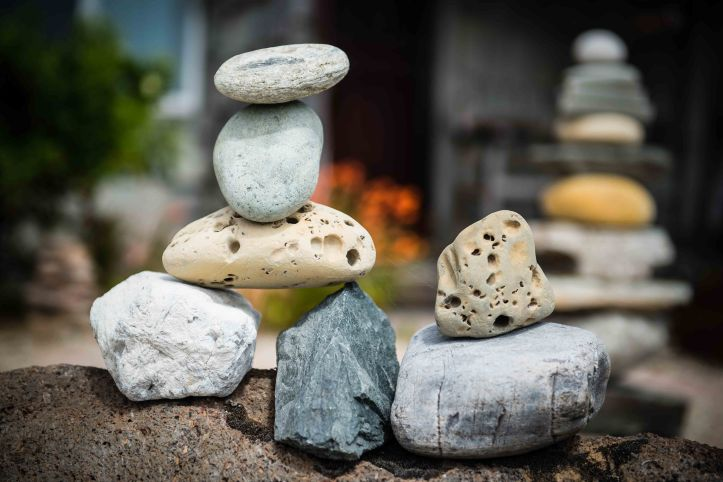 Stacked rocks in a front yard.