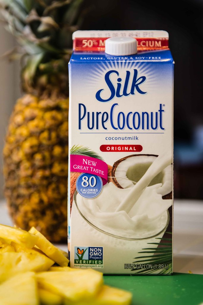 Add approximately 8 oz. of coconut milk and blend until smooth.